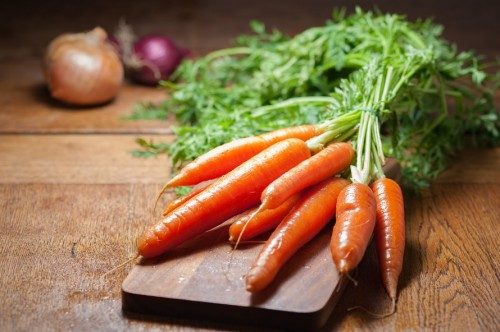 Carrot on Brown Chopping Board